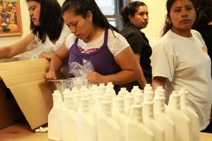 The women from the Si Se Puede Coop bottling their new cleaner.